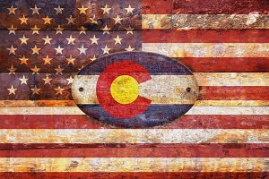 USA and Colorado flags.