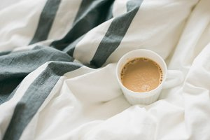 Coffee cup among sheets