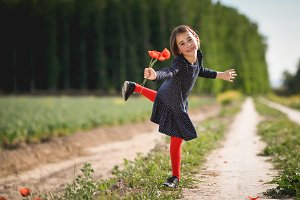 Little girl in nature wearing dress