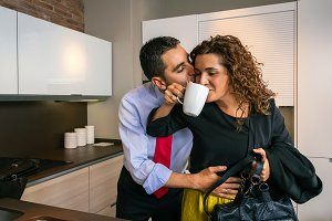Happy businessman embracing and kissing woman at breakfast