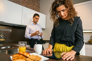 Couple having fast breakfast before go to work