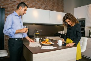Couple looking news while having fast breakfast