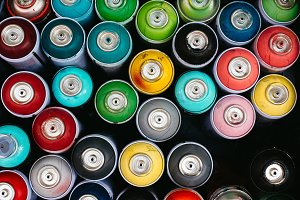 Cluster of spray paint cans, above