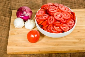 Red sliced tomatoes garlic and onion