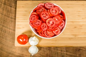Bowl of sliced tomatoes and garlic