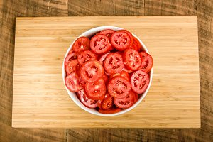Bowl of red sliced tomatoes