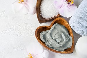 Cosmetic face and body mask of blue clay. Spa setting. Top view