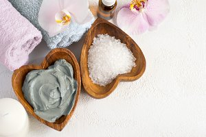 Spa background. Cosmetic face and body mask made of blue clay