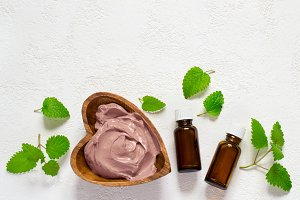 Cosmetic face mask and body made of pink clay, mint leaves