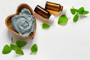 Cosmetic face mask and body made of blue clay, mint leaves