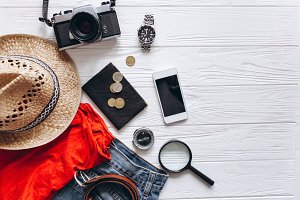 Travel set on wooden background