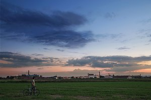 Man with bike at sunset