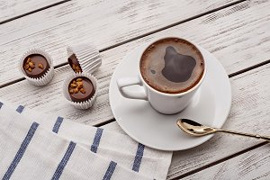 Hot coffee and chocolate sweets.