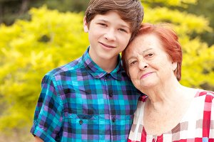 Senior woman with teenage boy