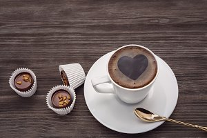 A cup of coffee with a heart.