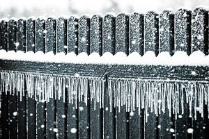 Icicles on fence with snow
