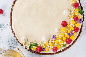 Chocolate tart with mango and raspberries