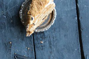 healthy food vintage concept, cake and spoon on rustic wooden table