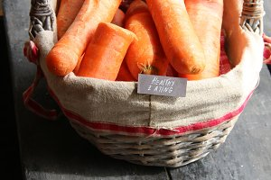 Healthy eating retro concept, tag and Carrot in the basket