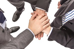Business partners with hands above
