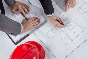 Architects hands review project plan