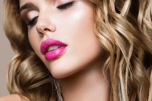 Glamour portrait of beautiful woman model with fresh makeup and romantic wavy hairstyle.