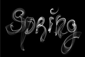 Spring lettering word written with white smoke or flame light isolated on black background