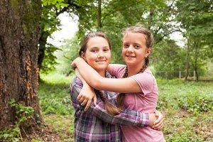 Two sisters hugs