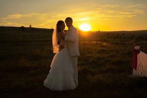 Wedding couple on sunset