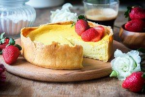 Homemade vanilla cheesecake with fresh strawberries