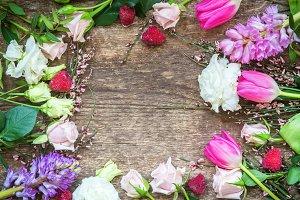 Flower frame on wooden background