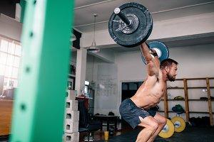 Powerful bodybuilder heavy lifting