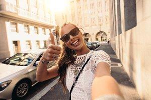 Tourist taking selfie in a street