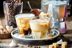 Iced coffee with cream being poured