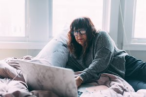 A woman in her 50s working from home