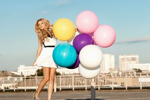 girl flying with big balloons