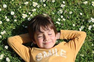 happy kid lying in the garden
