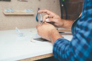 Crop hands of craftsmen at working