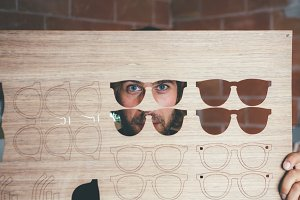 Craftsman looking through wooden blank