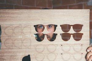 Craftsman looking through wooden blank
