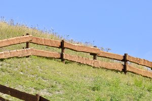 Wooden fence in a hill