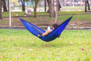 man lying on hammock in garden