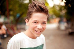 Smiling teen boy outdoors