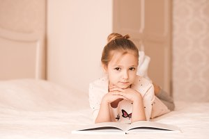 Child girl reading book