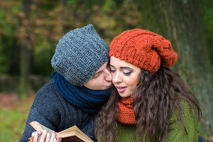 loving couple reads a book