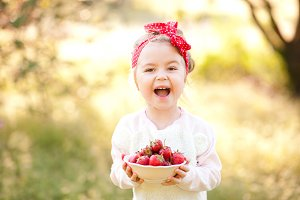 Funny girl with strawberry