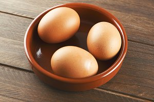 Eggs on wooden table. Horizontal shoot.