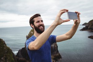 Man taking selfie from mobile phone
