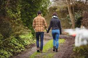 Couple walking on dirt track