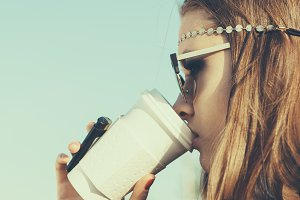 girl in sunglasses drinking coffee